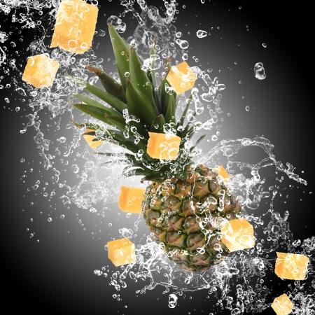 Pineapple with water splash over dark background