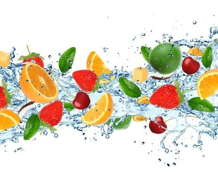 Fruit with splashing water over white Reklamní fotografie