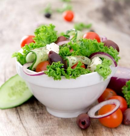 greek salad: Fresh salad over white background