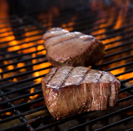 barbecue fire: closeup of a steak on grill