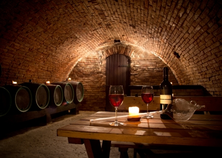 tavern: Wine cellar with wine bottle and glasses Stock Photo