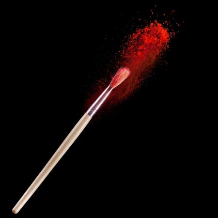 make up brushes: Make up brushes with powder isolated on black