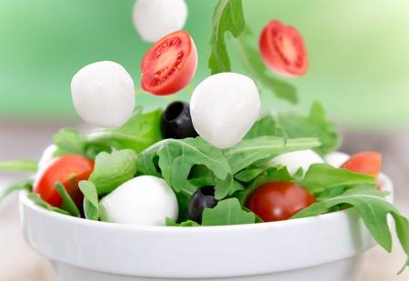 greek chef: Fresh salad on wooden background Stock Photo