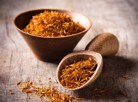 intense flavor: Saffron on wooden background