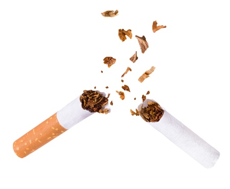 quit smoking: Quit smoking, breaking the cigarette over white Stock Photo