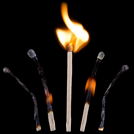 matchstick: Blue safety matches over black background