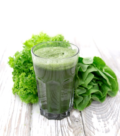 spinach: Healthy green vegetable juice on wooden table