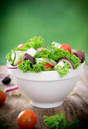 greek chef: Fresh salad over wooden background Stock Photo