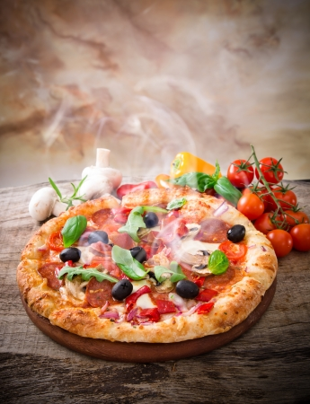 cuisine: Delicious italian pizza served on wooden table