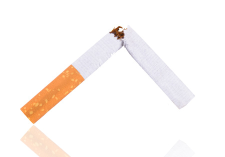 nicotine: Quit smoking, breaking the cigarette over white Stock Photo