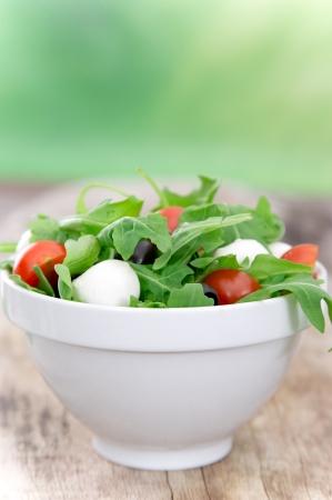 greek chef: Fresh vegetable salad over wooden background Stock Photo