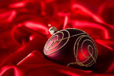 Red luxury satin with christmas balls photo