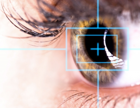Beautiful Eye with laser, close-up  Stock Photo