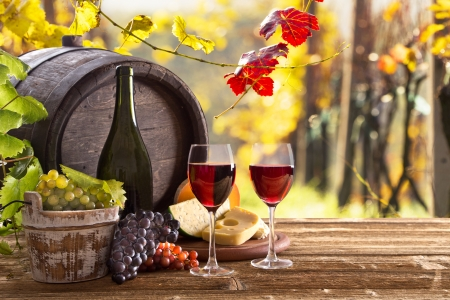 still life of wine: Wine bottle and glasses with wodden barrel