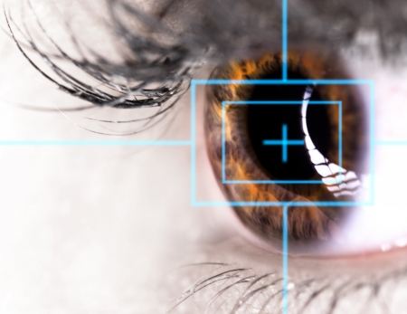 eyes wide: Beautiful Eye with laser, close-up  Stock Photo