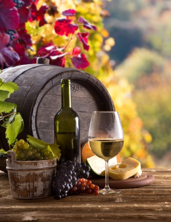 italian landscape: Wine bottle and glasses with wodden barrel