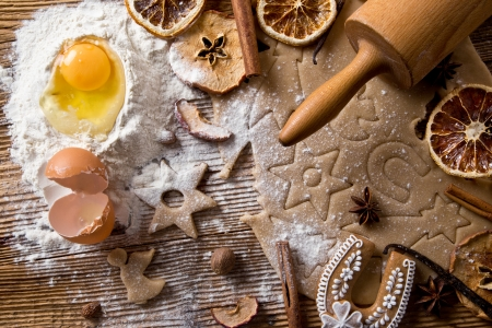 Baking utensils, spices and food ingredients on wooden background photo