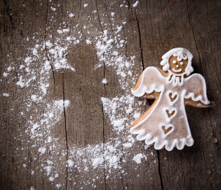 Christmas Gingerbread on woodne table photo