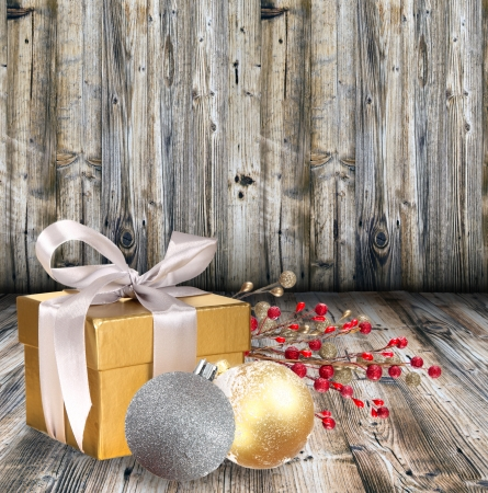 Christmas gift on wooden background photo