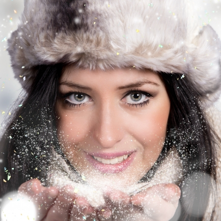 Portrait of attractive young woman in wintertime photo