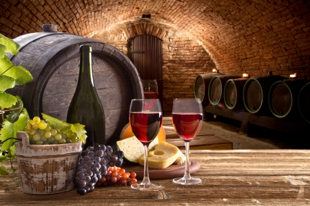 Wine bottle and glasses with wodden barrel Stock Photo