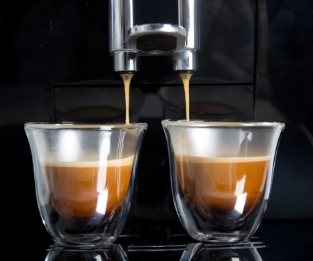 espresso machine: golden espresso flowing into the cups