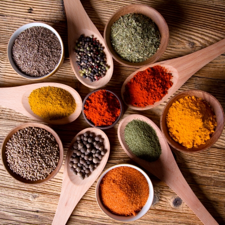 Assorted spices on wooden background photo