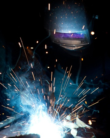 welding mask: Working welder. Construction and manufacture theme. Stock Photo