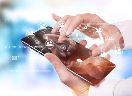 デジタル タブレット、近代的な技術の概念に触れて手 写真素材