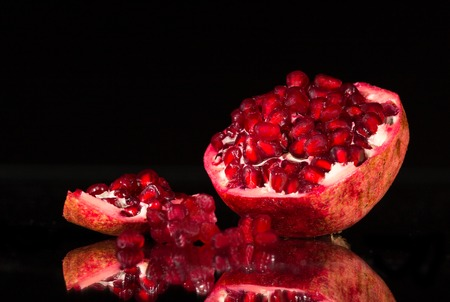 pomergranate: Ripe pomergranate on black background