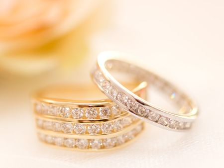 Gold and silver wedding rings on a cushion photo