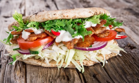 Doner Kebab - grilled meat, bread and vegetables photo