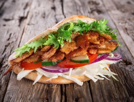 chicken kebab: Doner Kebab - grilled meat, bread and vegetables
