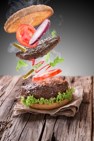 Delicious hamburger on wooden  photo