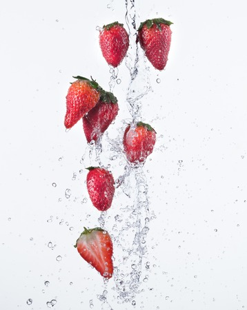 Strawberries with water splash isolated on white