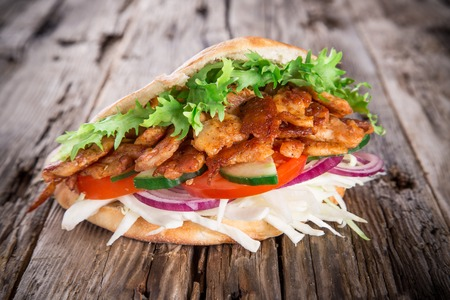 pita bread: Pita bread and Kebab meat on wooden background Stock Photo