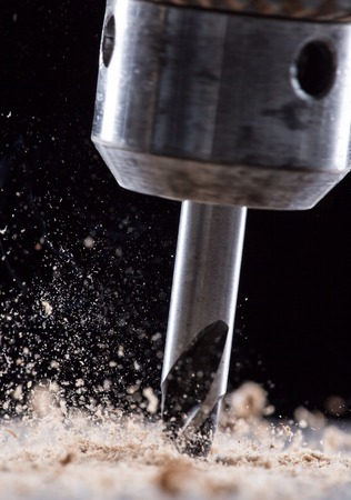 chuck: Close-up view of a metal drill chuck