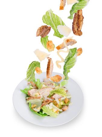CHICKEN CAESAR SALAD: Caesar salad with chicken and greens  Stock Photo