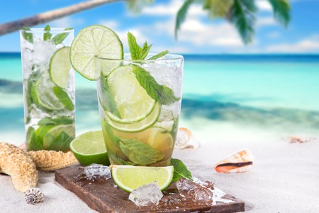 cocktail drinks: Fresh mojito drink on beach