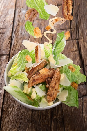 salad plate: Caesar salad with flying ingredients.