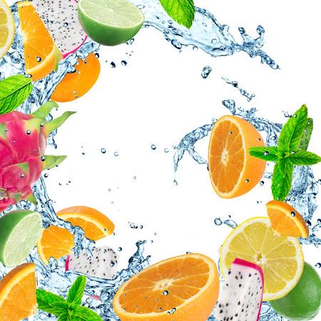 fruit background: Fresh fruit with water splash on white background. Stock Photo