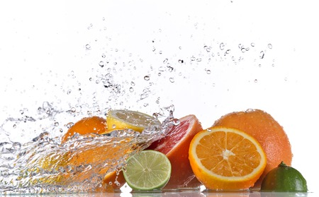 Fresh fruit with water splash over white background