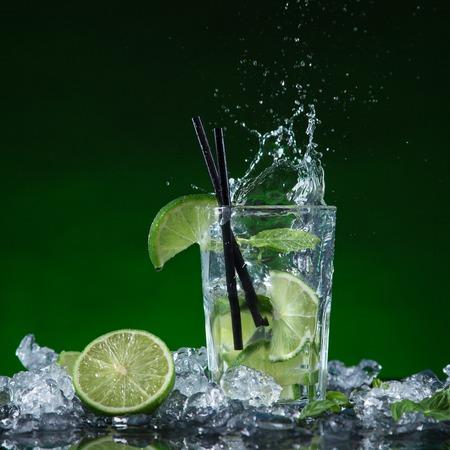 Fresh fruit cocktail in freeze motion splashing, close-up