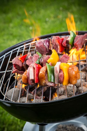 bbq background: Tasty skewers on the grill, close-up