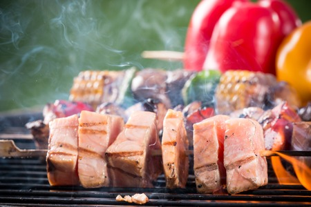 kabob: Tasty salmon skewers on the grill, close-up