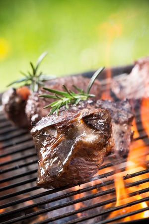 charcoal grill: Grilled beef steaks on the grill, close-up