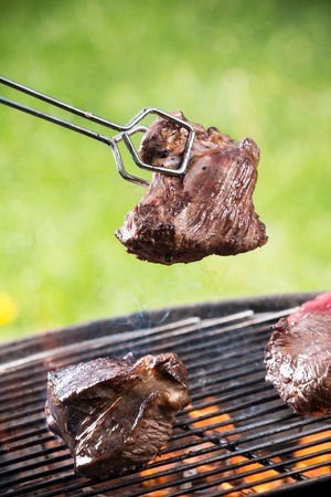 Grilled beef steaks on the grill, close-up  photo