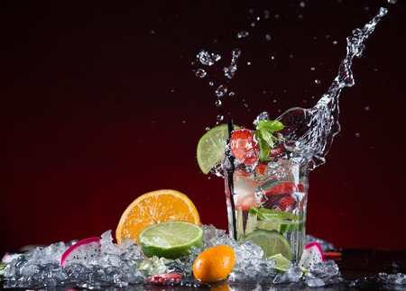 martini shaker: Fresh fruit cocktail in freeze motion splashing, close-up