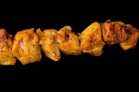 Tasty skewers on black background, close-up  photo
