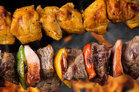 Tasty skewers on black background, close-up  Stock Photo